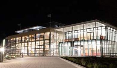 exterior of the new congress theatre conference facility in eastbourne at night time